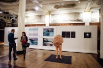 The central exhibition space, featuring a sculpture by Andrea Hasler, a mixed media work by Yi Dai, and photographs by Rafaela Rocha, Marcelo Deguchi da Silva and Val Masferrer-Oliveira.